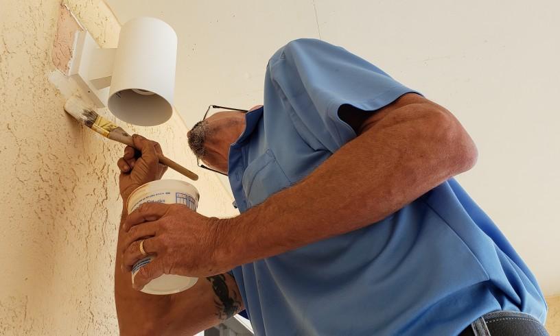 man fixing cracks